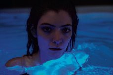photo of lorde in a pool from melodrama album booklet